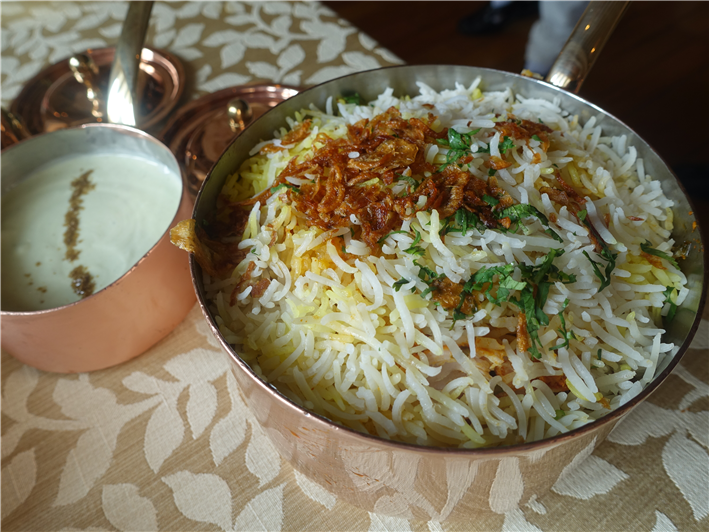 chicken biryani served
